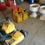Okonski Push Lawnmower and gas tanks